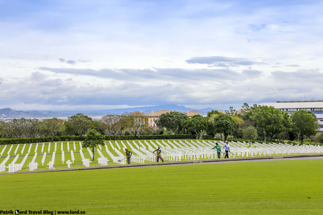 Manila American Cemetery, Workers maintaining the cemetery, Manila, Philippines © Patrik Lord Travel Blog