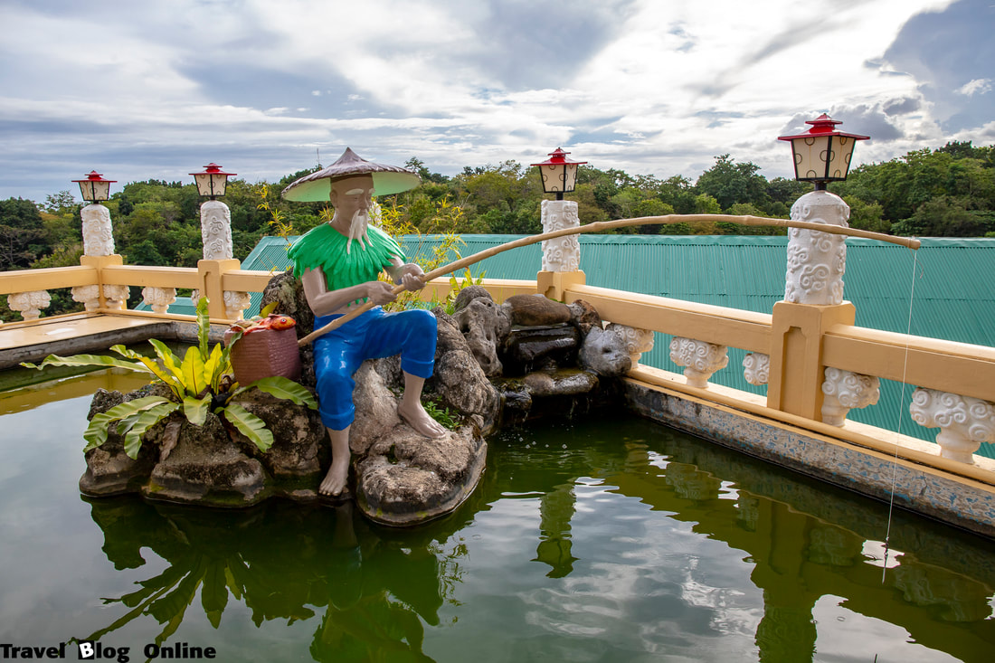 Cebu Taoist Temple, Fisherman in the pond, Cebu City, Philippines © travelblogonline.com