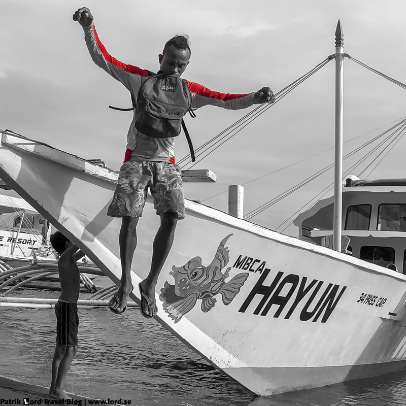 Dauin, Guy jumps from a boat, Negros, Philippines © Patrik Lord Travel Blog