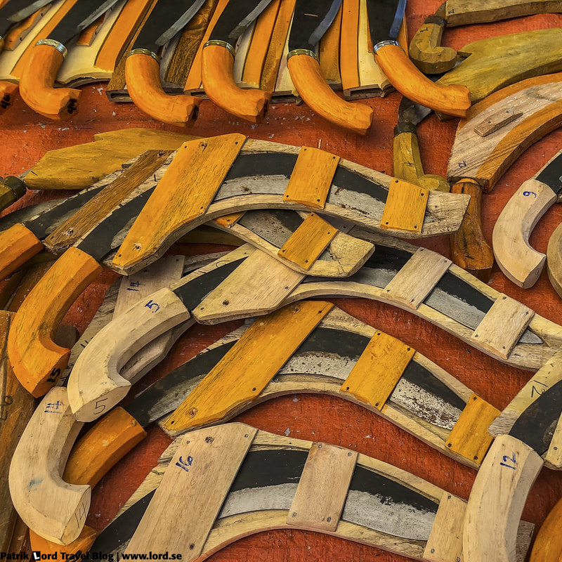 Knives, Malatapay market, Apo Island, Philippines © Patrik Lord Travel Blog